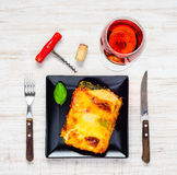 Baked Lasagna Pasta with Rose Wine royalty free stock photos
