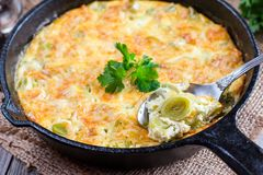 Baked leeks with cheese stock photography