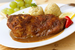 A  baked leg of goose with dumplings,salad Stock Image