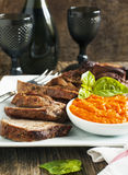 Baked leg of Lamb with red pepper sauce Stock Image