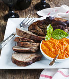 Baked leg of Lamb with red pepper sauce Stock Photos