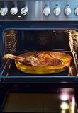 Baked leg of lamb. With roasted potatoes Stock Photography