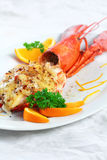 Baked lobster with cheese Stock Images