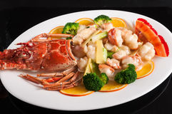 Baked lobster with ginger and scallion Stock Photos