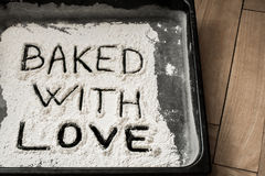Baked with Love Word Written on Baking Sheet Covered with White Flour Royalty Free Stock Photos