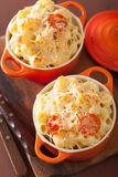 Baked macaroni with cheese in orange casserole Stock Photo