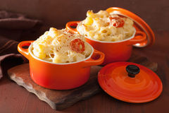 Baked macaroni with cheese in orange casserole Royalty Free Stock Photos