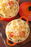 Baked macaroni with cheese in orange casserole. S royalty free stock photo