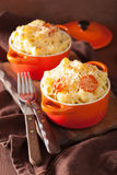 Baked macaroni with cheese in orange casserole Royalty Free Stock Images
