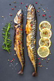 Baked Mackerel Fish with Herbs and Lemon on Stone Royalty Free Stock Photo