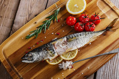 Baked mackerel with tomato Royalty Free Stock Image