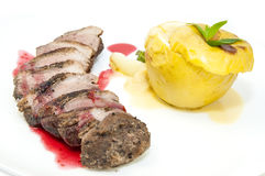 Baked meat with apple Stock Photography