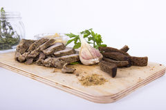 Baked meat. On the Board, with spices and bread. on a white background Stock Photo