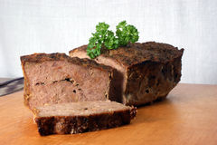 Baked meat loaf with parsley on a timber board Royalty Free Stock Image