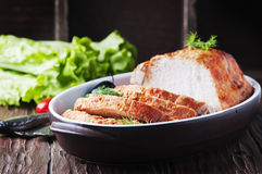 Baked meat with olive on the wooden table Royalty Free Stock Image