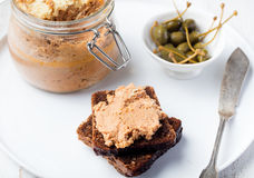 Baked meat pate in jar and on bread Gourmet food Stock Images