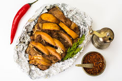 Baked meat with quince slices. Studio Photo Stock Images