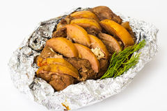 Baked meat with quince slices. Studio Photo Stock Photo