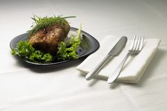 Baked Meat on served Table with White Tablecloth Royalty Free Stock Photo