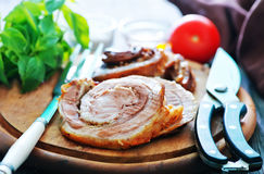 Baked meat. With spice on wooden board Royalty Free Stock Photography