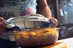Baked meat and vegetables in the  glass dish with open lid Royalty Free Stock Images
