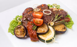 Baked meat with zucchini and eggplant Stock Photo