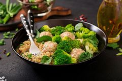 Baked meatballs of chicken fillet with garnish with quinoa and boiled broccoli. Proper nutrition. Sports nutrition. Dietary menu stock photos