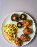 Baked meatballs with mushrooms Royalty Free Stock Image
