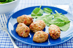 Baked meatballs with pepper and spinach Stock Image