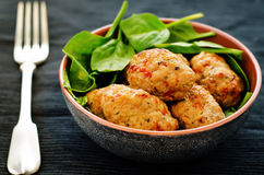 Baked meatballs with pepper and spinach Royalty Free Stock Photography