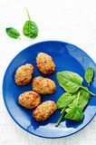 Baked meatballs with pepper and spinach Stock Photos