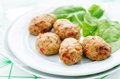 Baked meatballs with pepper and spinach Royalty Free Stock Images