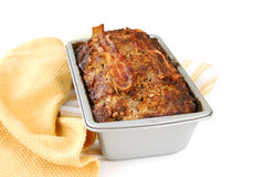 Baked meatloaf in the pan. A freshly baked meatloaf in the pan with bacon on top Stock Photo