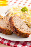 Baked meatloaf with potato salad Royalty Free Stock Image