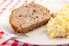 Baked meatloaf with potato salad Stock Image