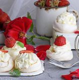 Baked meringue with cream and fresh strawberries Royalty Free Stock Photography