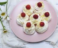 Baked meringue with cream and raspberry berries Stock Photo