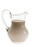 Baked milk. In glass on white background stock photos