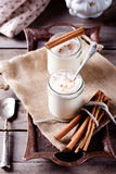 Baked milk yogurt with cinnamon in glass jars Stock Image