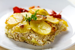 Baked moussaka dish on a wooden board Royalty Free Stock Images
