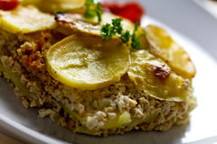Baked moussaka dish on a wooden board Royalty Free Stock Image