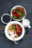 Baked muesli with fresh berries and yogurt for breakfast Royalty Free Stock Images