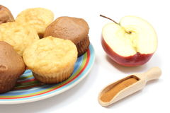 Baked muffins, fresh apple and powdery cinnamon on white background Royalty Free Stock Photography