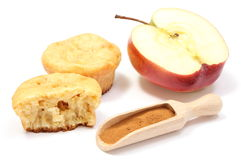 Baked muffins, fresh apple and powdery cinnamon on white background Stock Photography