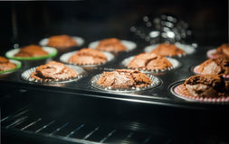 Baked muffins through oven glass Royalty Free Stock Image