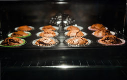 Baked muffins through oven glass Stock Photos