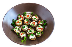Baked muhrooms with blue cheese, red pepper and spring onion Royalty Free Stock Photos