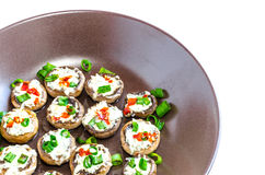 Baked muhrooms with blue cheese, red pepper and spring onion Stock Photography
