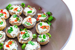 Baked muhrooms with blue cheese, red pepper and spring onion Royalty Free Stock Images