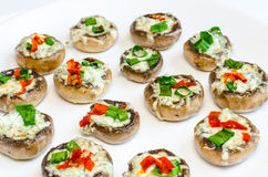 Baked muhrooms with blue cheese, red pepper and spring onion Royalty Free Stock Image